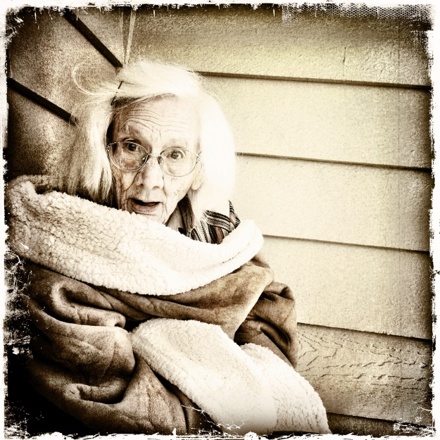 Grandma enjoys sitting on the front porch.  And goofing for the camera.