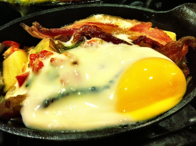 Baked bacon, egg, cheese, pico and potatoes.