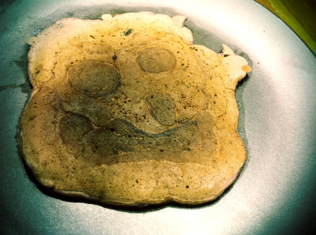 My own pancake was not quite as amused as Grandma's.