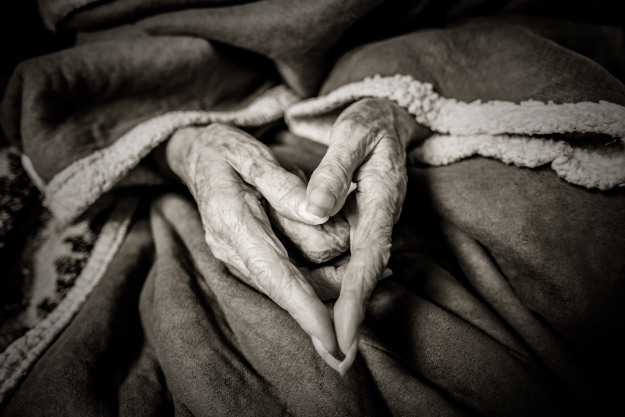 Grandma makes a heart.