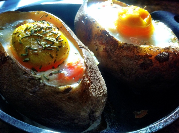 Roasted egg cooked  in baked potato with pico de gallo, cheese and bacon