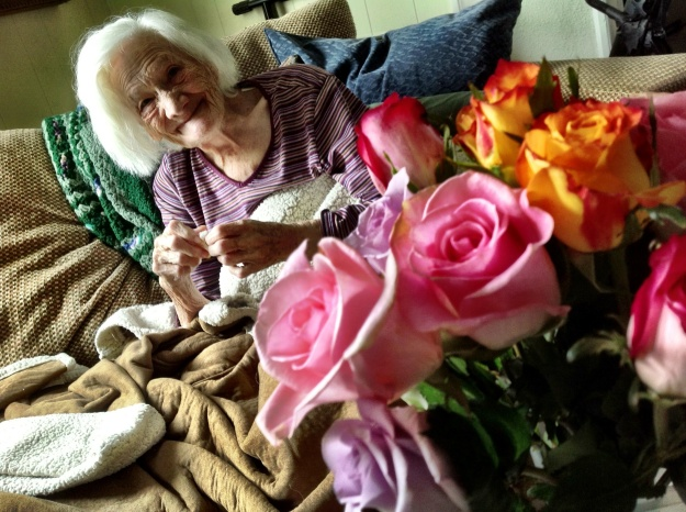 Grandma enjoys her flowers.