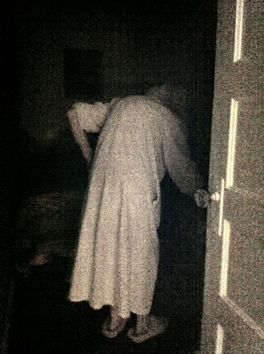 Grandma disappears into her room on the way to bed.